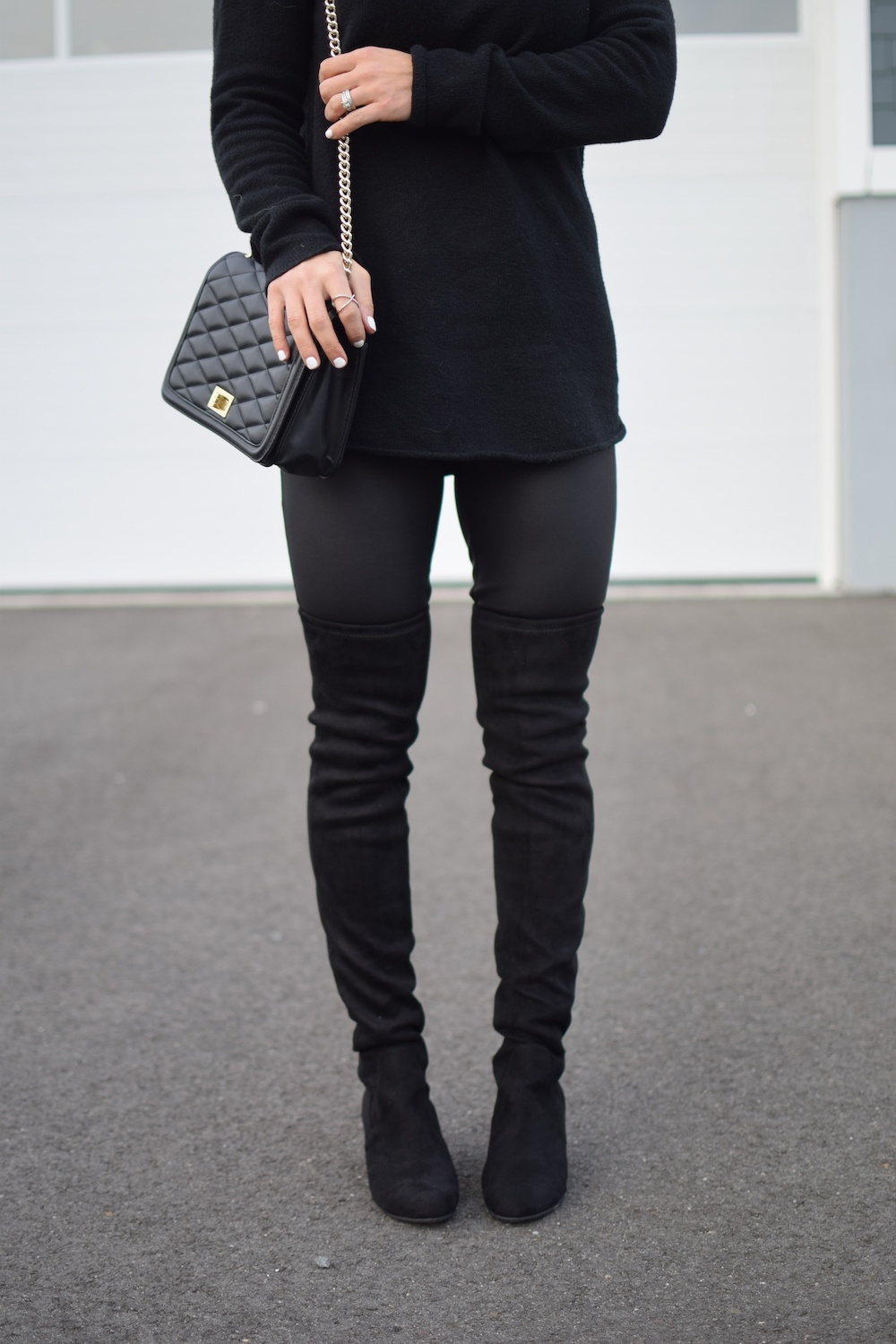 black quilted purse  - How To Style Faux Leather Leggings by popular New Jersey fashion blogger Fit Mommy in Heels
