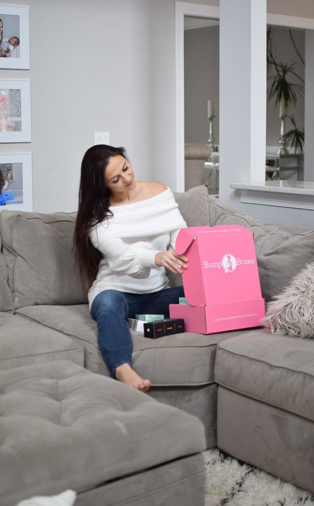 girl opening pregnancy box subscription