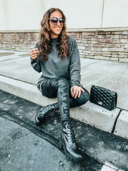 casual outfit with camo leggings, combat boots, and black long sleeve t-shirt