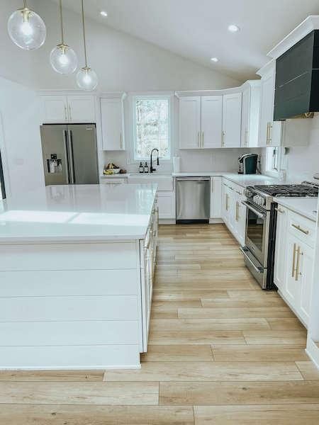 coretec lvp in white kitchen - coretec flooring review