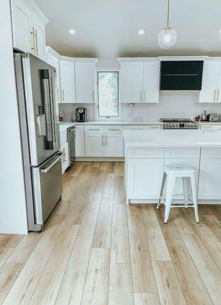 coretec luxury vinyl plank in white kitchen - coretec flooring review
