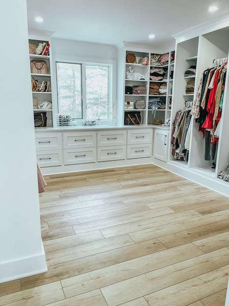 master closet with luxury vinyl plank floors