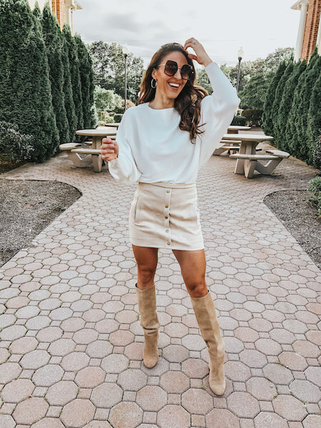 woman in white sweater and tan skirt - cheap online boutiques