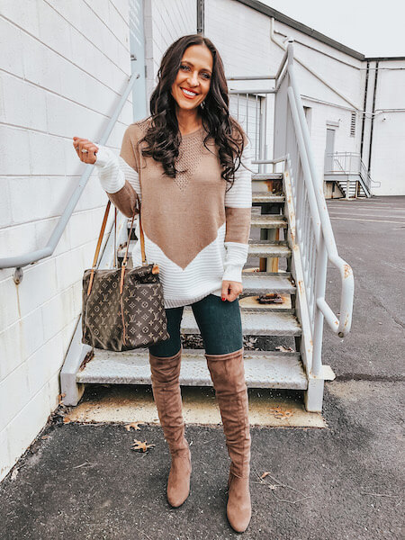woman in chevron sweater and jeans outfit