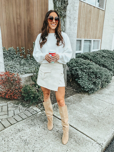 woman wearing white sweater and tweed skirt - how to wear an oversized sweater