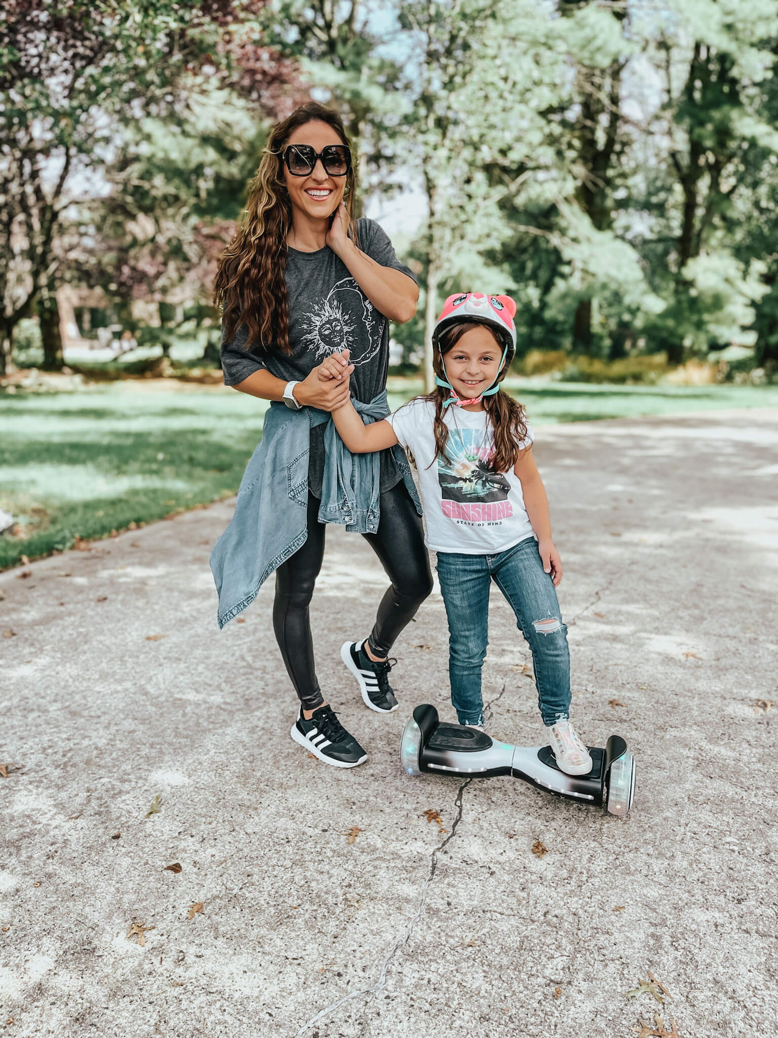 mom and daughter on hoverboard - outdoor gifts for kids
